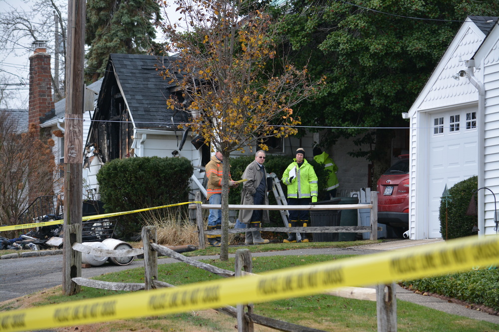 The Suffolk County Police Homicide Squad and Arson Squad investigate the fatal fire.