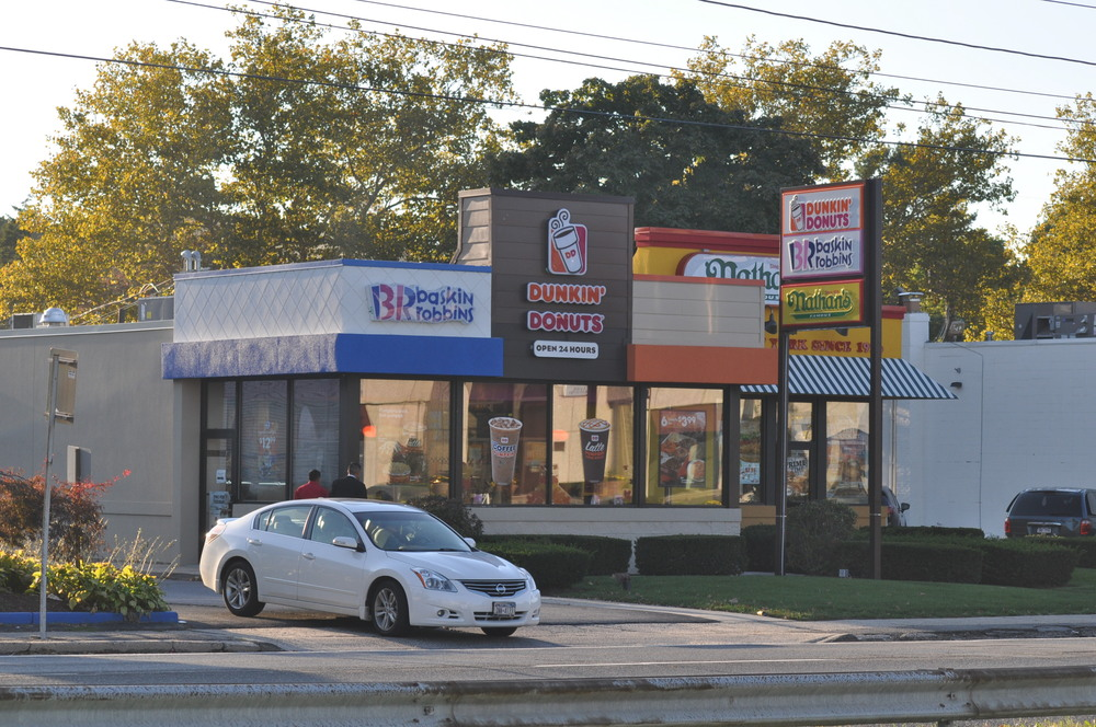 The owners of this Dunkin' Donuts franchise are suing the town's Zoning Board of Appeals after the board rejected variances needed to build a drive-thru. (Long Islander News photo/archives)
