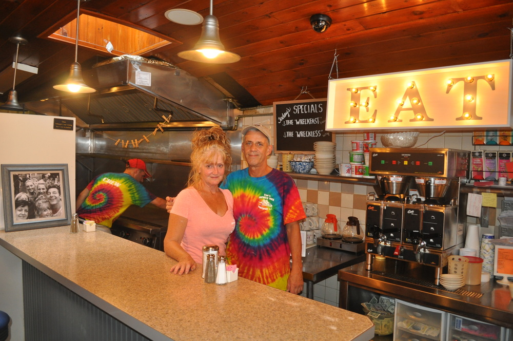 Janet Eckel and Tim Hess welcome patrons to Tim's Shipwreck Diner on Saturday for a fundraiser to help Northport's John Carberry.