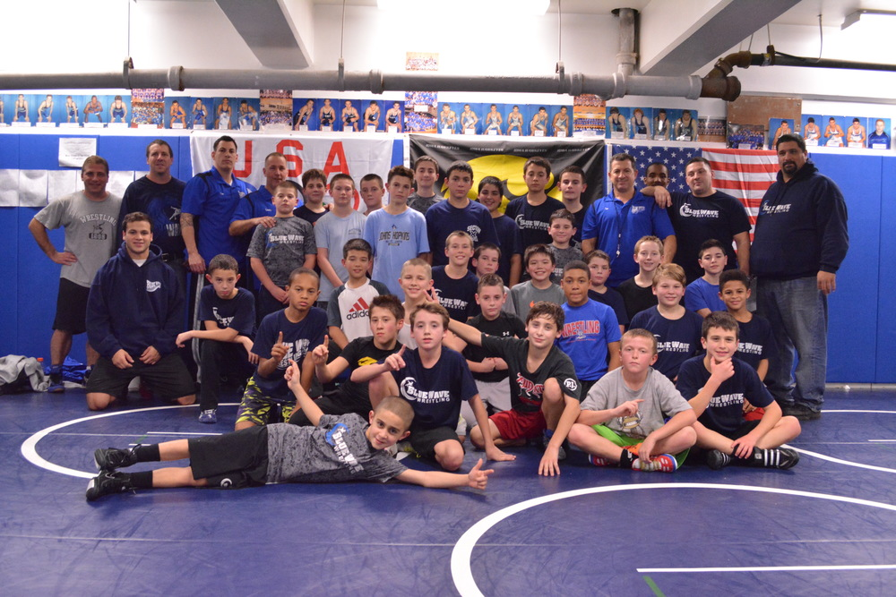 The Blue Team of Elwood's Blue Wave youth wrestling program poses for a picture during a practice in the wrestling room of Elwood John H. Glenn High School on Dec. 8.