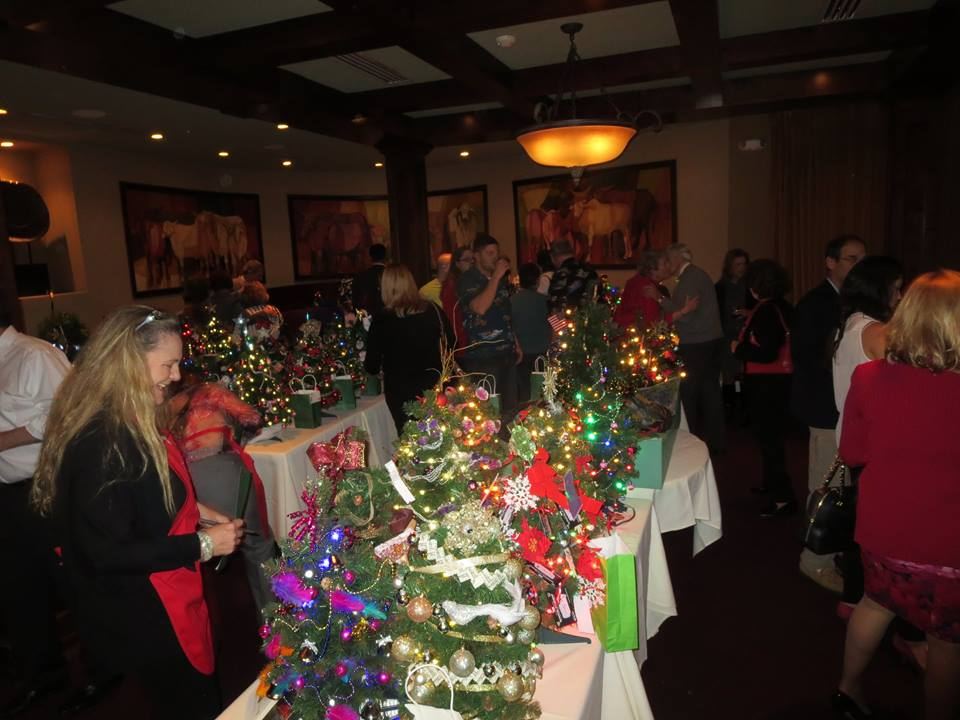 The Huntington Rotary's first-ever Festival of Trees, held at Mac's Steakhouse, raised $7,000 for a beloved club member who had been critically injured.