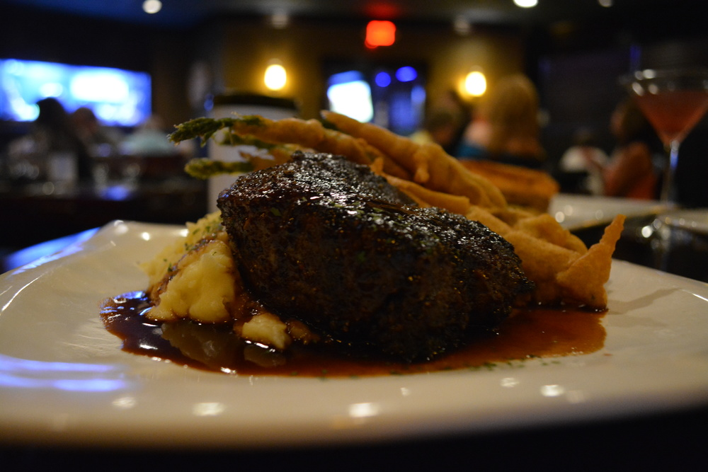 The Pan Roasted 10 oz. Filet Mignon ($36) at Black & Blue Seafood Chophouse shares a plate with whipped potatoes and tempura asparagus, in a shallow sea of Bordeaux Sauce.   (Black & Blue Seafood Chophouse, 65 Wall Street, Huntington, 11743. 631-385-9255)  Long Islander News photo/ Arielle Dollinger