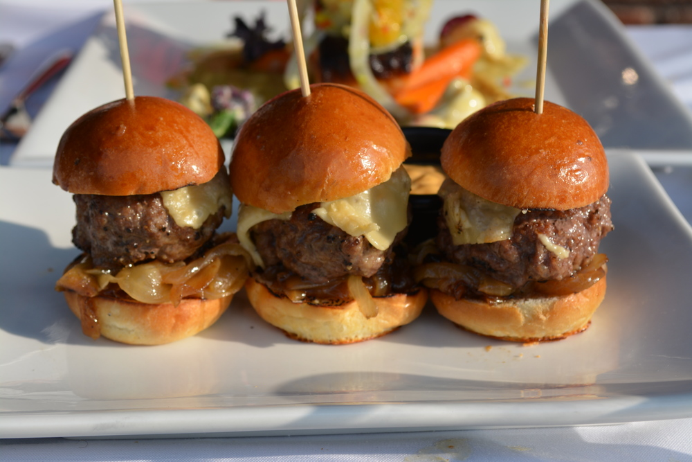Sliders ($14) at Char Grille are plated in groups of three. Also on the menu are regular-sized beef burgers as well as bison burger and chicken breast options. (Char Grille, 26 Clinton Ave., Huntington. 631-923-3400)  Long Islander News photo/ Arielle Dollinger