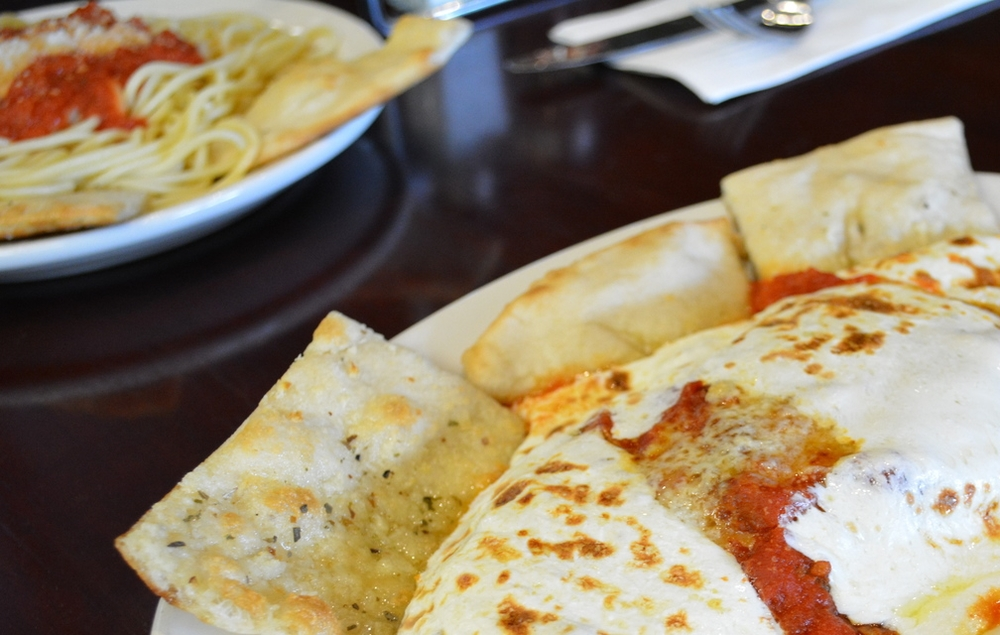 The Chicken Parmigiano ($13.75) at Massa's – baked in a coal oven, as noted on the menu – is topped with fresh mozzarella and served with pasta. (Massa's Coal-Fired Brick Oven Pizza, 345 Main Street, Huntington, 631-923-FIRE (3473),   www.massaspizzeria.com  )  Long Islander News photo/ Andrew Wroblewski