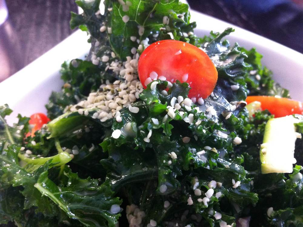 Kale salad, complete with hemp seeds and apple cider vinaigrette, at The Purple Elephant Market Café. (Purple Elephant Market Café (81B West Fort Salonga Road, Northport, 631-651-5002)  Long Islander News photo/ Arielle Dollinger