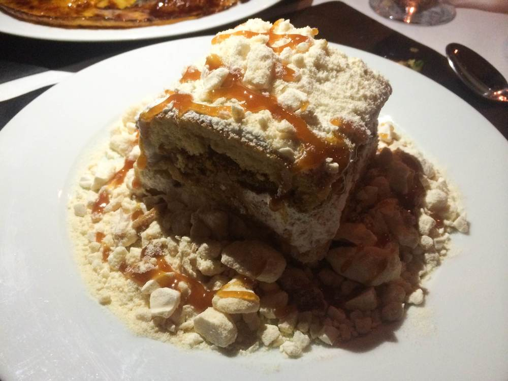 The Chaja ($9), on the dessert menu at Sur, is a sponge cake filled with layers of whipped cream, peaches, Dulce de Leche and walnuts. The cake is topped with crumbled Meringue. (Sur Argentinian Steakhouse, 314 New York Avenue, Huntington, 11743. 631-470-6300)  Long Islander News photo/ Arielle Dollinger