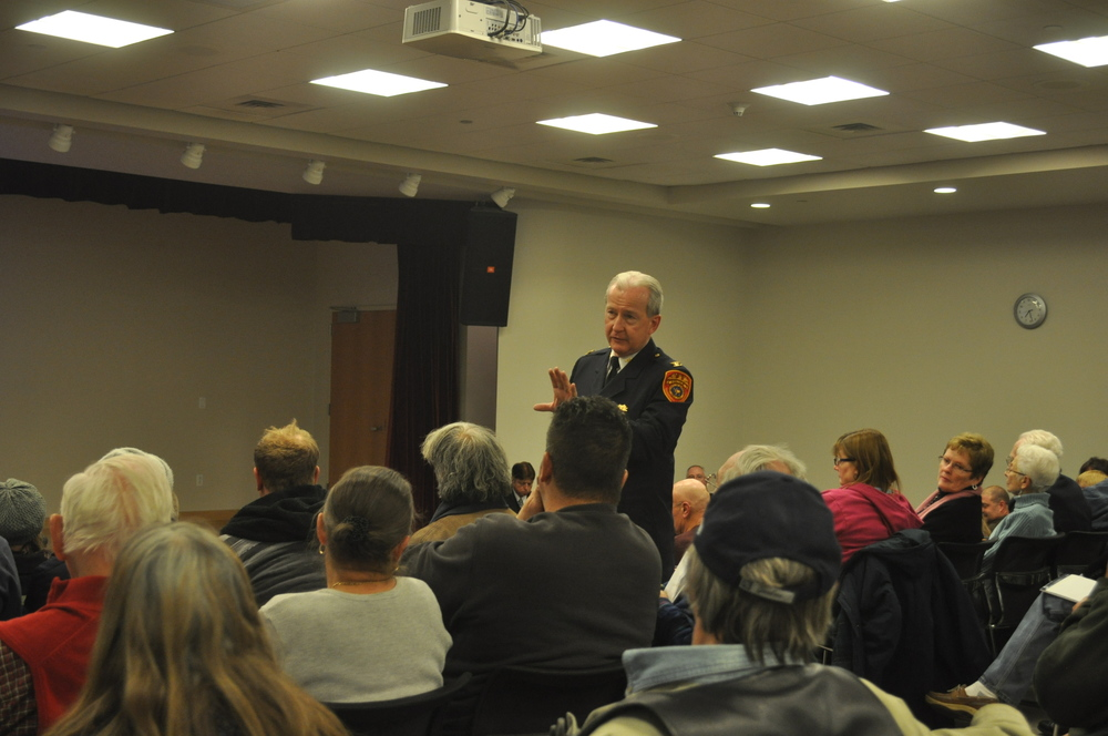 Second Precinct Inspector Edward Brady responds to complaints of loud, drunken parties in a Wilson Street house in East Northport at a Nov. 19 Second Precinct community meeting.