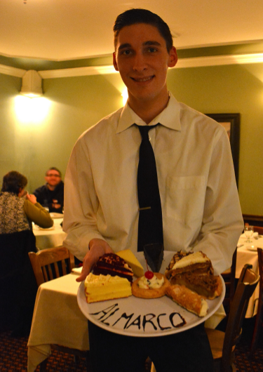 Waiter Matt displays the Almarco dessert tray.