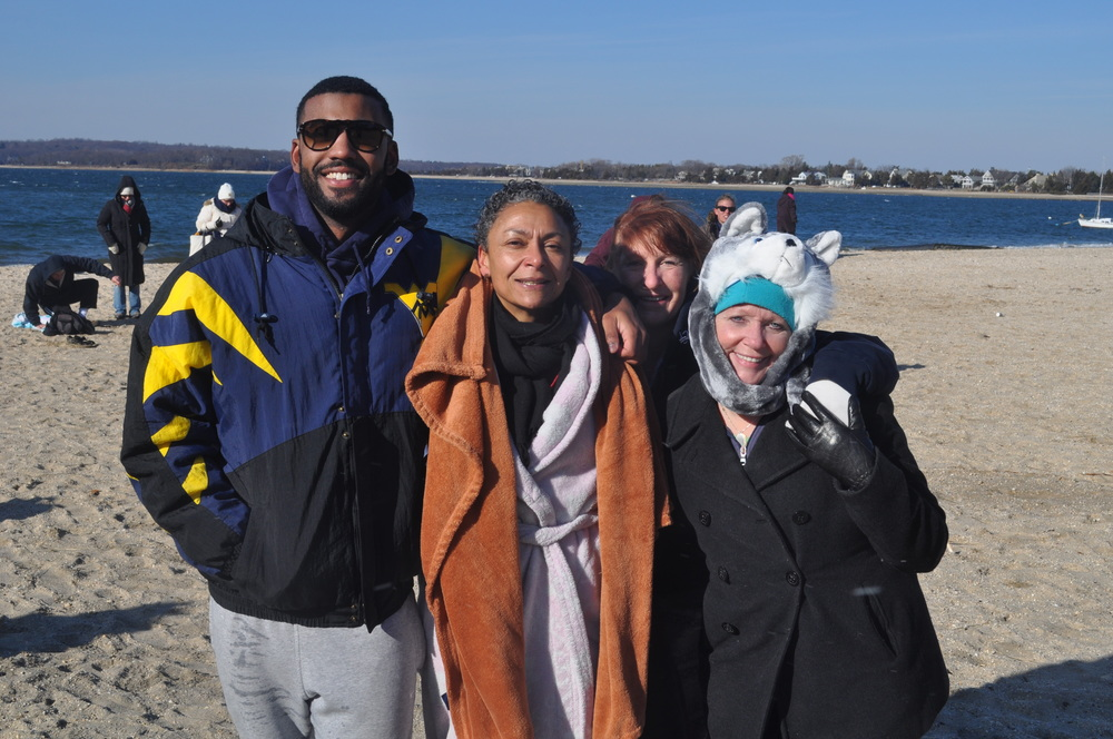 For Huntington's Jake Gayle, it's all in the family – from left, he joined his mom, Jane and her best friend, Tracey Kuzzinski, in taking the plunge. Jake didn't hold back, belly-flopping into 2015. Wendy Brofman also joined them.