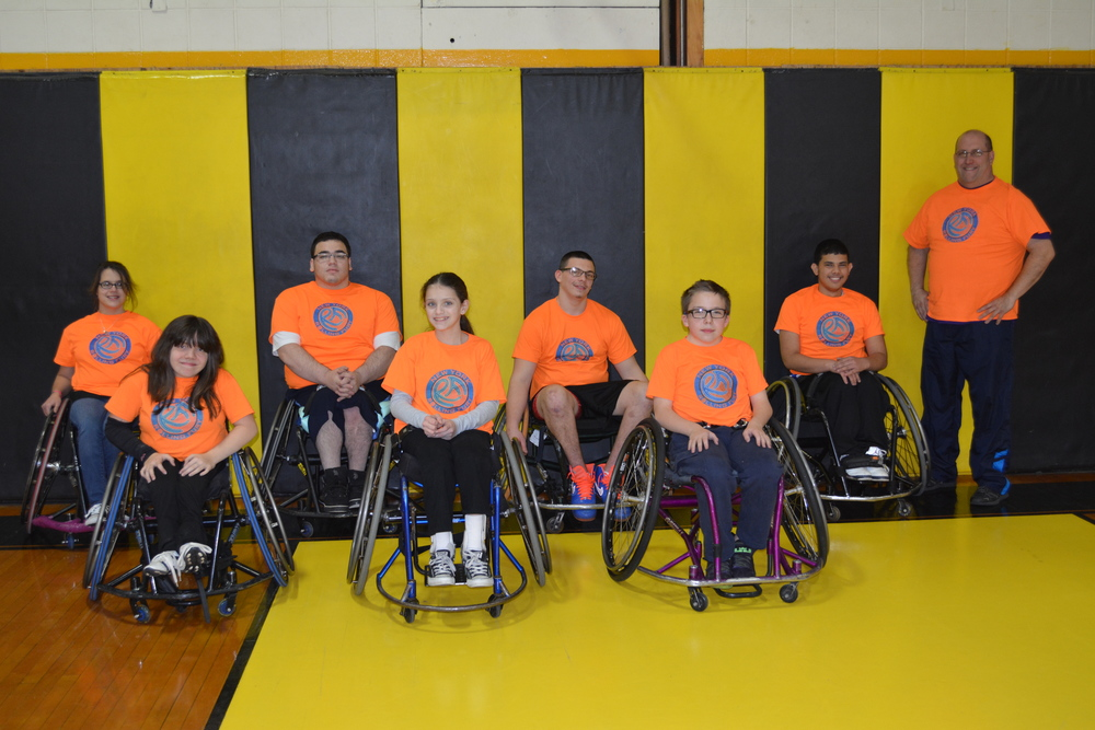 Meet the Rolling Fury – from left: Victoria O'Brien, Breanna Clark, Alex Ruiz, Meghan Chiodo, Alex Obert-Thron, Travis Ancewicz, Marcos Taveras and Coach Sean Clark of the New York Rolling Fury pose for a picture after a practice on Saturday at St. Anthony's High School.