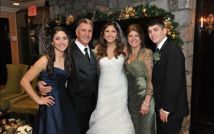 The Bosco family – Angela, John, Amanda, Michelle and John – at Amanda's wedding in 2014.