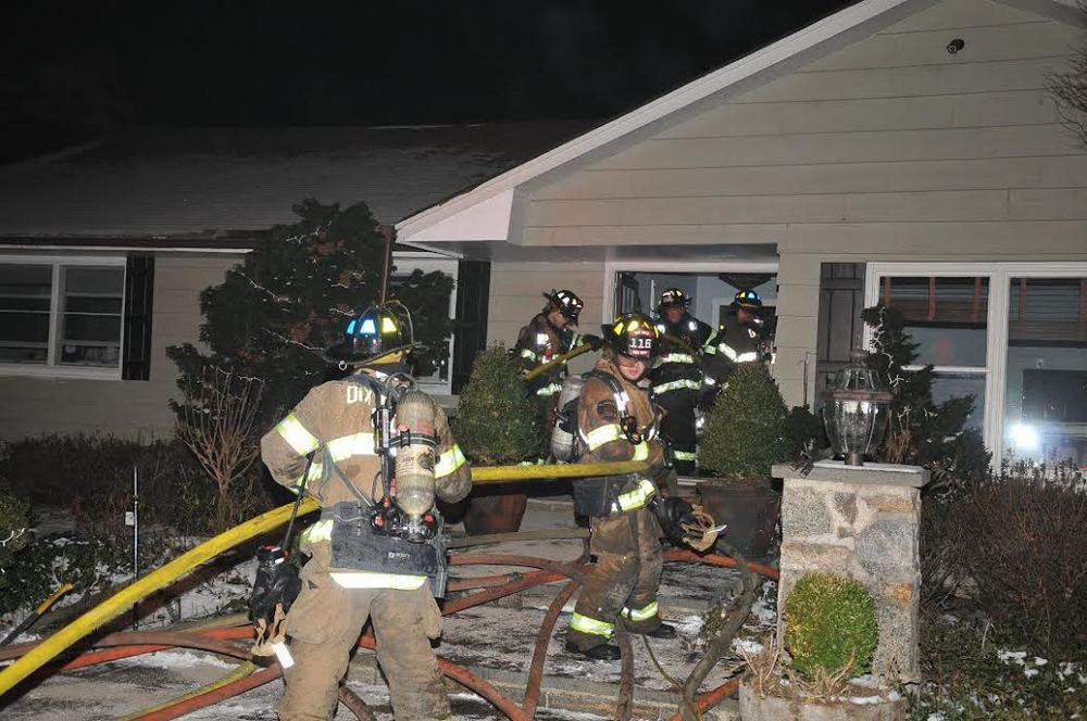 Firefighters battled an attic fire at a Dix Hills home Saturday. (Photo by Steve Silverman)