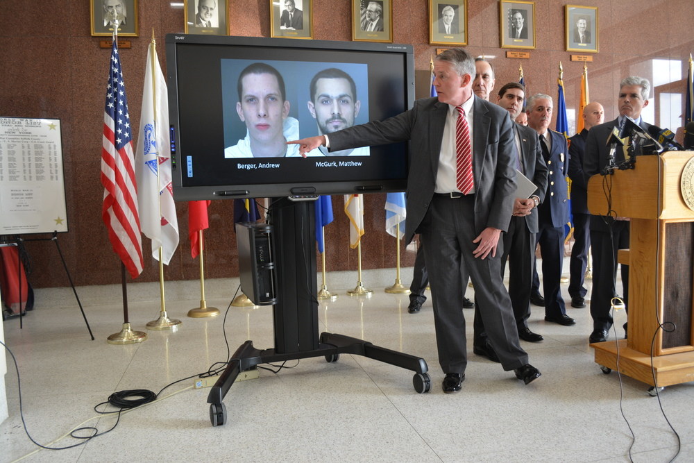 Suffolk Chief of Detectives William Madigan at a press conference today points to mug shots of Andrew Berger and Commack resident Matthew McGurk, who are suspected of robbing several gas stations and doughnut shops since Dec. 22.