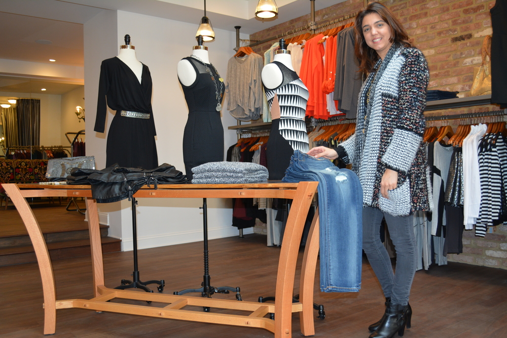 Owner Joanna Koelmel shows off some of the fine offerings Blue Bird NY Boutique has available in its Huntington village store.