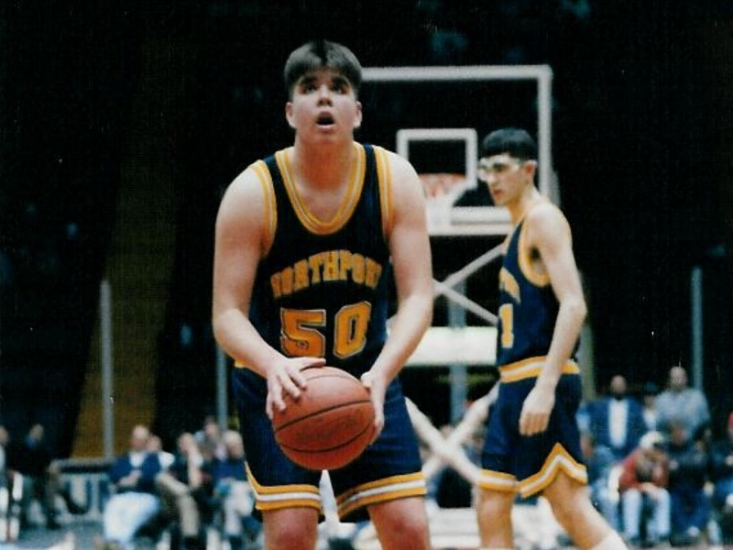 Greg Dunne, a Class of 1995 graduate from Northport High School, prepares to take a foul shot in the Tiger uniform.