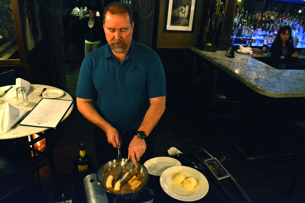 TC prepares Bananas Foster tableside.