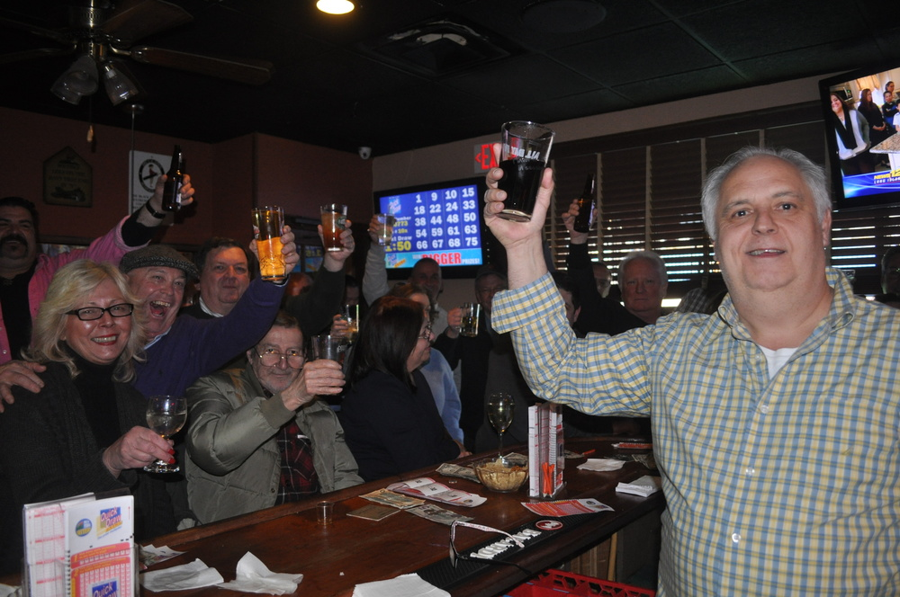 Pine Tree Inn owner Charlie O'Keefe leads patrons in a toast Saturday during a farewell party at the restaurant, which closed its doors after 58 years in business Monday.