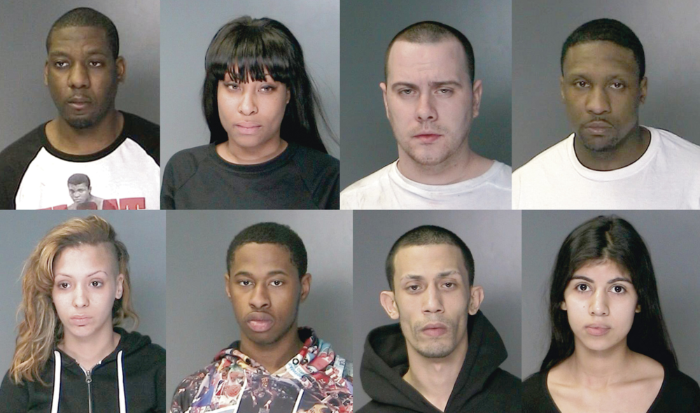 From left: Karl Latortue, Nadine Parker, Brian Ochsenreiter, Bruce Giles, Christine Gatling, Joshua Crowell, Alex Otero and Melissa Saldarriaga were arrested Thursday morning after a search warrant was executed by Suffolk County police at 72 Rutgers Lane in Greenlawn.