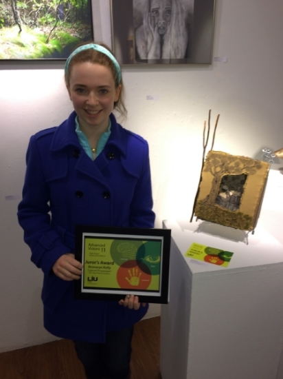 Bronwyn Kelly, of Huntington, stands with her award-winning piece.