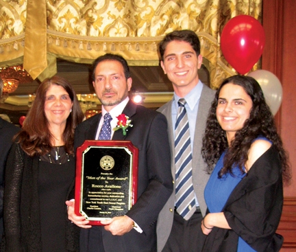 Rocco Avallone, left-center, receives the 2015 Italian-American Man of the Year and poses with his family.