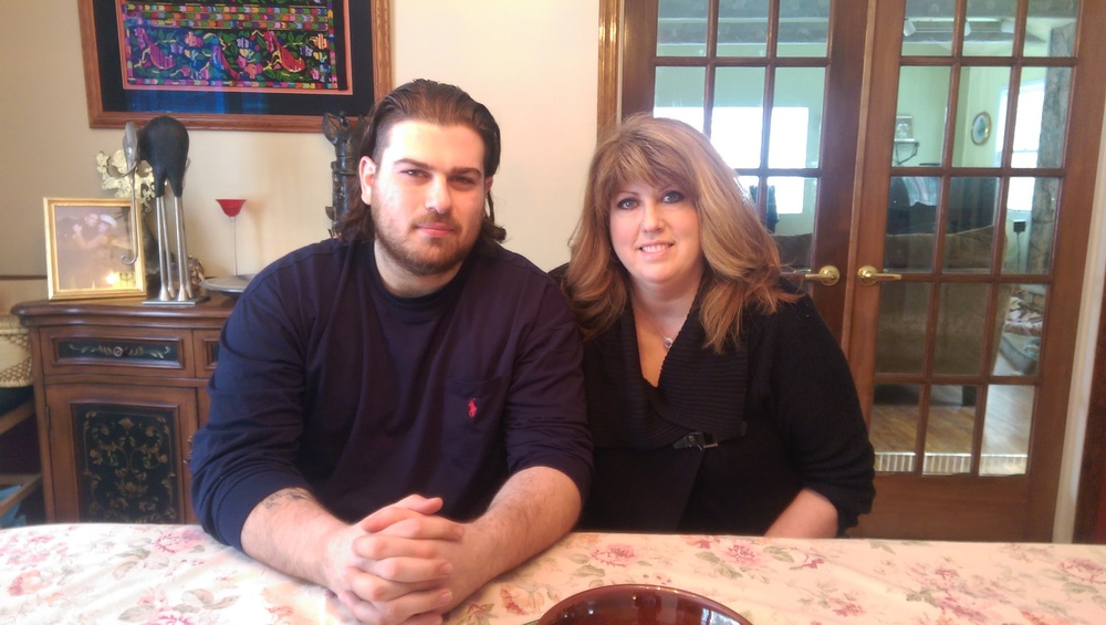 Cynthia and Bijan Assemi sit at their dining room table after sharing their story.