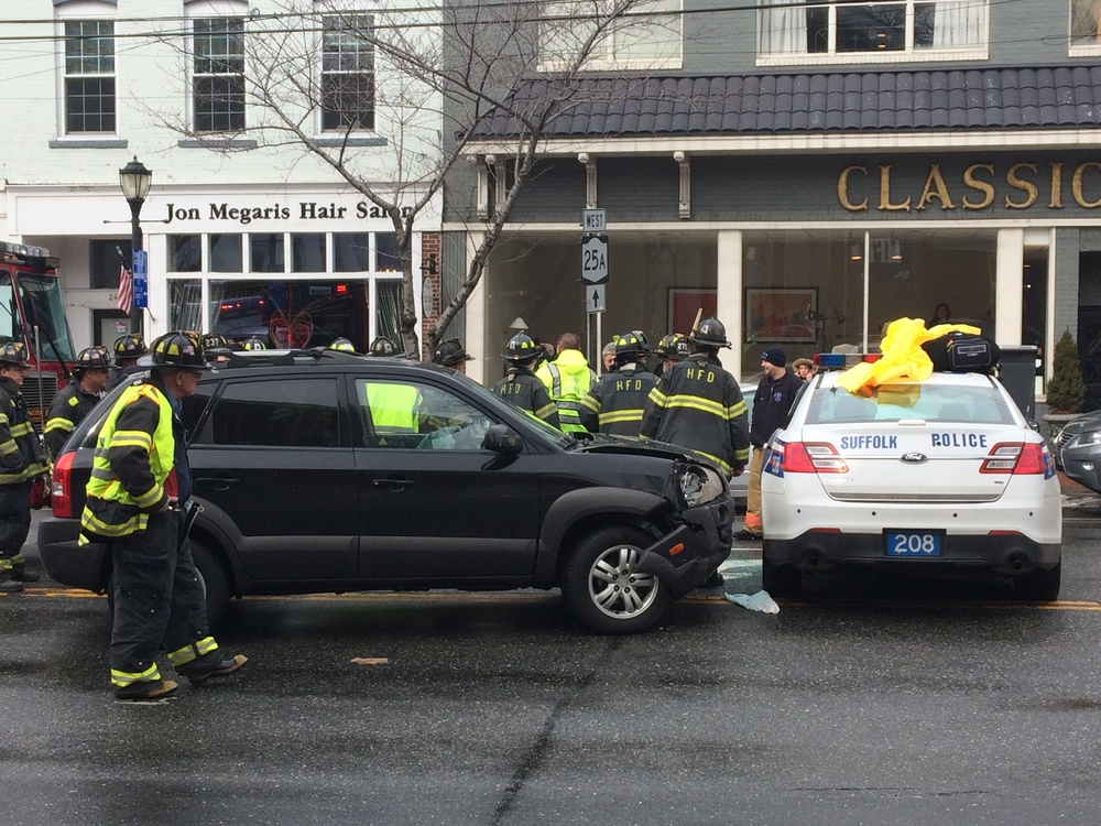 A Suffolk County police cruiser hit a Hyundai SUV Wednesday afternoon after making a U-turn on Main Street, police said.
