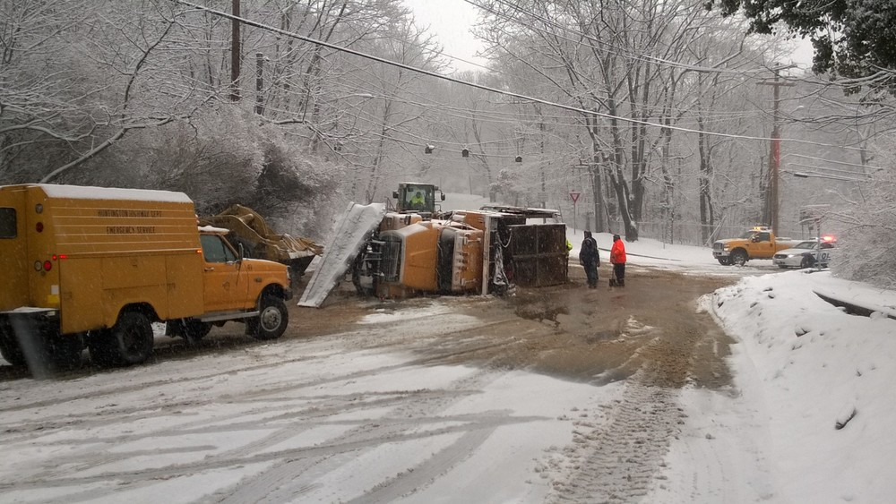 A Town of Huntington snowplow tipped over in Cold Spring Harbor (Photo by Daniel Bellissimo).