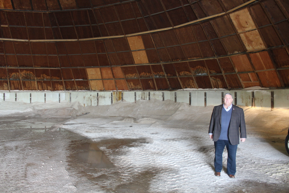 Superintendent of Highways Peter Gunther stands in the highway department's nearly-depleted sand barn at Rofay Drive in Huntington Wednesday. Ideally, the facility is so full you can't walk into it, Gunther said. (Long Islander News photo/Joseph Zapata)