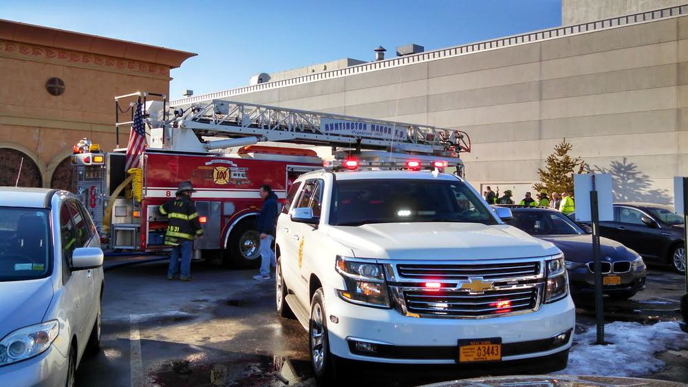 Huntington Manor Fire Department responded to the Walt Whitman Shops behind Cheesecake Factory Monday afternoon to fight a fire in an underground  transformer. (Photo by Steve Silverman)