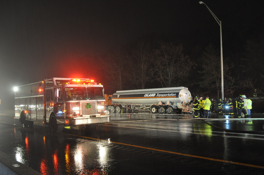 Melville Fire Department volunteers were among a phalanx of police and fire vehicles that responded Tuesday night to a tanker fire on the Long Island Expressway in Dix Hills. (Long Islander News photo/Danny Schrafel)
