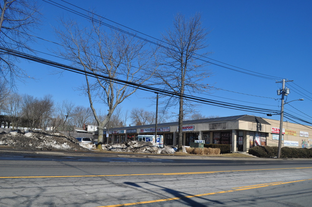 This shopping center in Elwood will soon become a TD Bank, elevations inset, after the town Planning Board awarded conditional site plan approval last month.