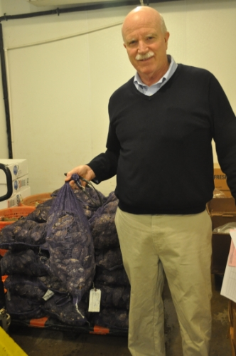 Northport's Tom Kehoe, holding a bag of clams from Oyster Bay in the Northport headquarters of K&B Seafood, said frigid temperatures this winter froze prime harbors like never before.