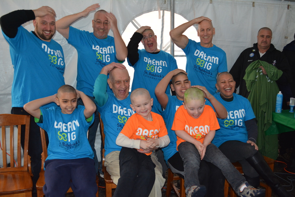 Newly shaved Finnegans, from top left, are: Ian Savage, Dan Finnegan, Jenifer Kelsch, Tom Finnegan – and from bottom left: Michael Finnegan, Joseph Finnegan, Peter Roddin, Michael Finnegan, Timmy Kelsch and Lacy Rose – are a part of the four generations of Finnegan-family members that shaved their heads together on Saturday during the annual Northport St. Baldrick's fundraiser at Napper Tandy's Irish Pub.