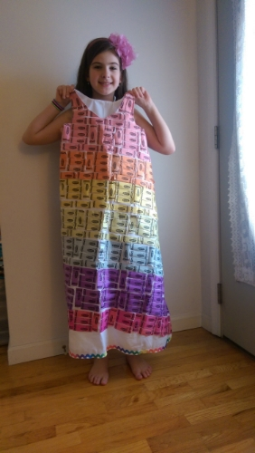 Miller holds up a dress she created using Crayola crayon wrappers for New Jersey Fashion Week.
