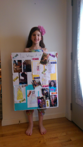 Miller holds up her mood board, which she used to get into New Jersey Fashion Week.