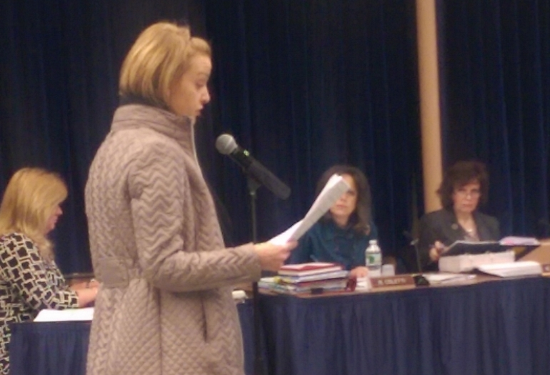 The Northport-East Northport Board of Education will be eliminating the arts chair position, despite protests from residents like Sarah Mackin (pictured).