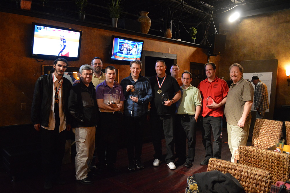 From left: Joe Maresca, Gordon Hedges, Dave Nangle, Andy Segal, Will Deyonker, Jim Glanville, Curt Gelinas, Andrew Sozio, Jamey Gray and Paul Danno – some of the best billiards trick shot players in the world – after Saturday's tournament in Huntington.