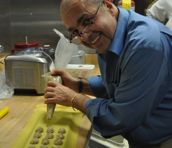 Luigi Petrone shows off the ravioli creation of the day in Tutto Pazzo's pasta room last week.