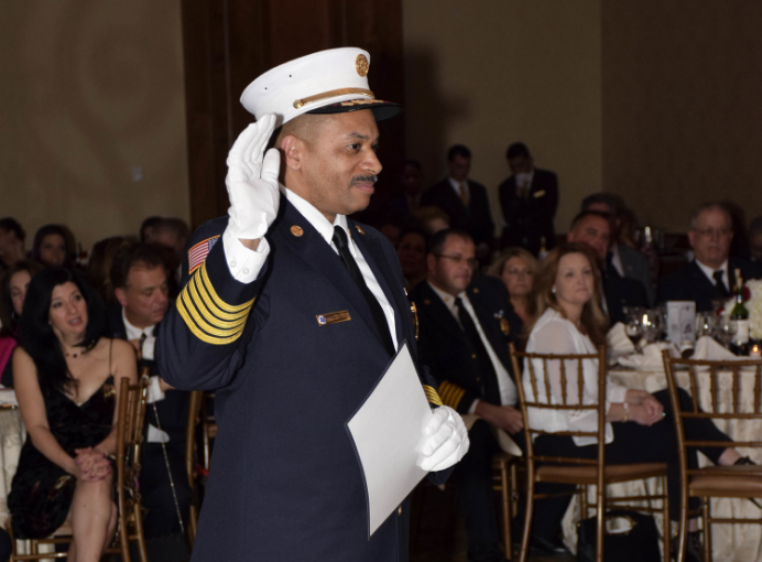 Greenlawn Fire Department Chief Kurt Allen takes the oath of office at the department's installment dinner Saturday.
