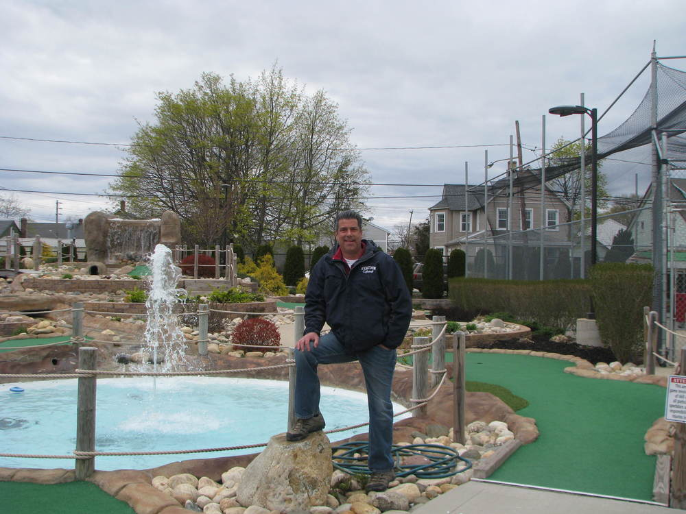 Brad Rosen's 18-hole miniature golf course features a fountain, streams, and other water-themed obstacles.