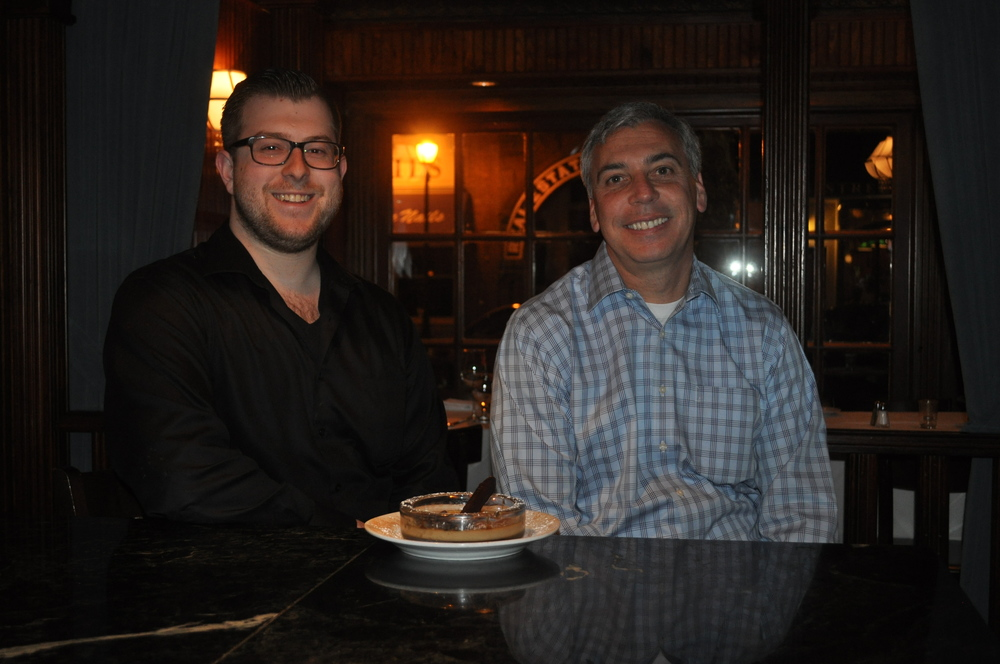 Co-owner Kevin LaPrelle and staffer Anthony Prufeta show off Bistro 44's famous coffee and cigar dessert.
