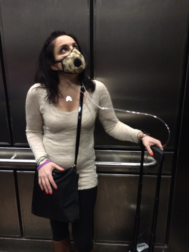 Whitman graduate Ann Marie Cortina must wear a mask to avoid picking up infections at the hospital, especially in the elevator.