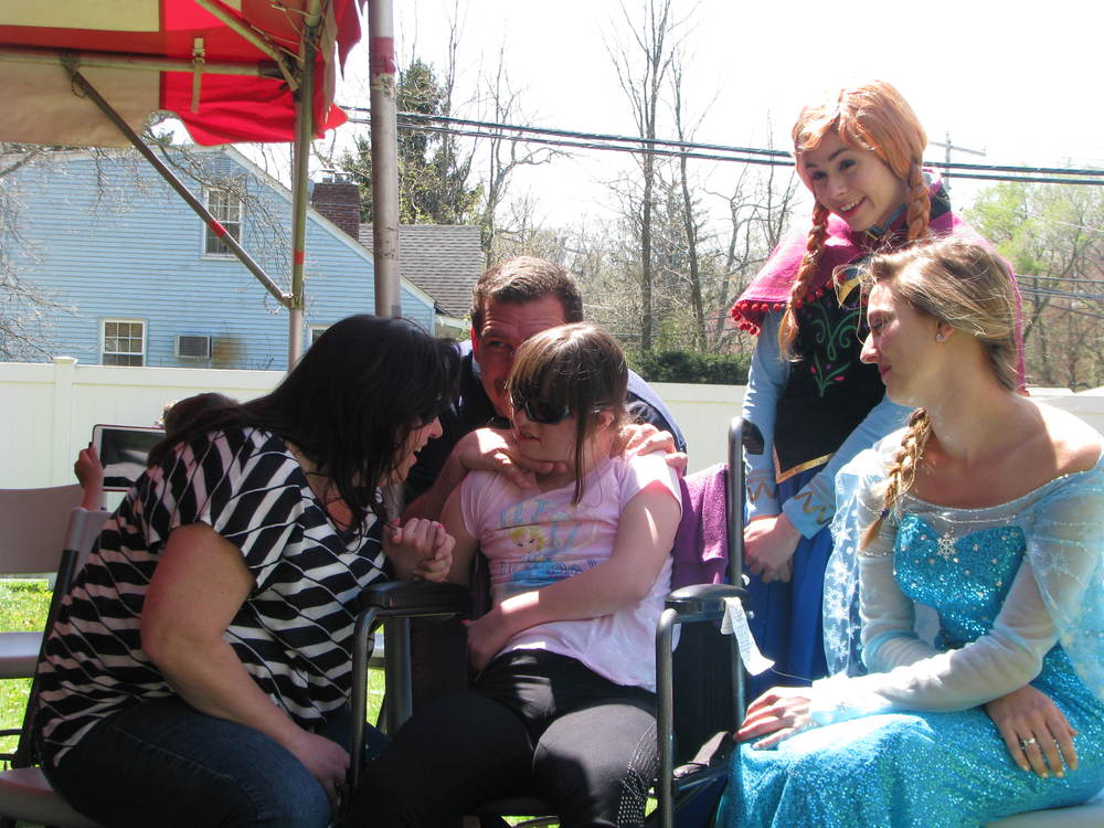 Marissa and her parents hang out with Elsa and Anna from Frozen.