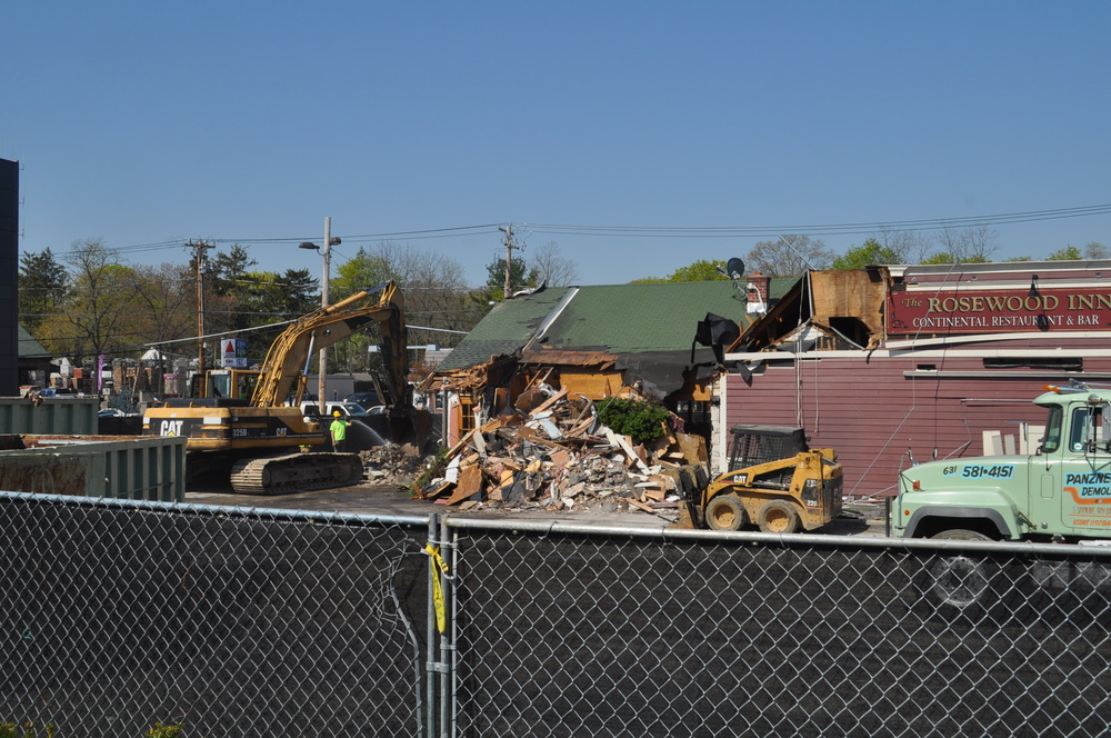 Work crews on Monday began to demolish former home of The Rosewood Inn to make way for a TD Bank.