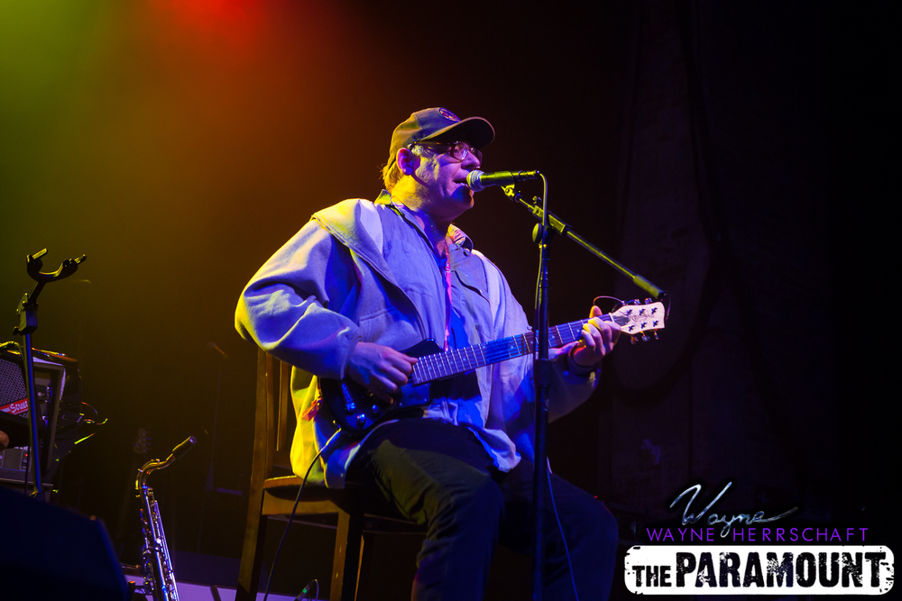 Eric Heftler, a Huntington village busker, went from the curb to The Paramount's stage on Saturday as he played an opening guitar set before Southside Johnny & The Asbury Jukes took the stage. (Photo by Wayne Herrschaft).
