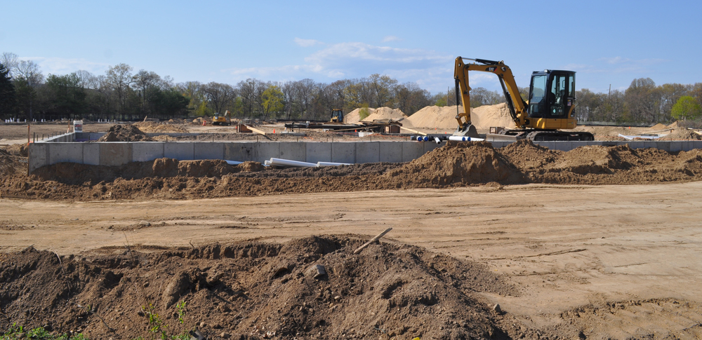 A concrete footing is in the ground at the site of the Highland Green Residences, which developer Peter Florey hopes to complete by next summer.