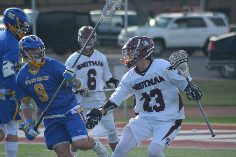 Colin O'Hara makes a move on a West Islip defender; the junior produced 33 points on 20 goals and 13 assists for the Wildcats over the course of the 2015 League II season.