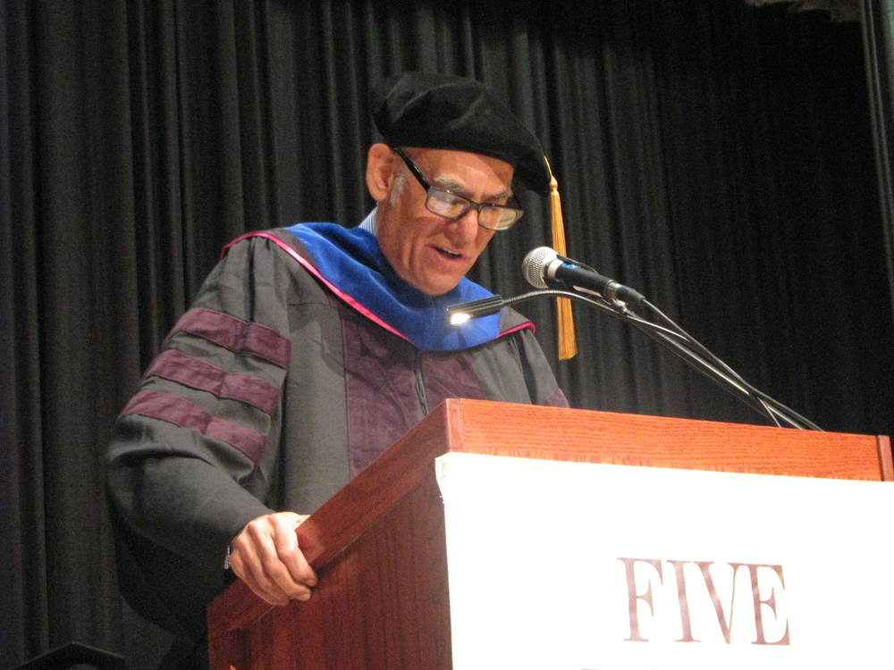 Acclaimed drummer Liberty DeVitto, a member of Billy Joel's original band, addresses the graduating class at Five Towns College on Saturday after receiving an honorary degree.