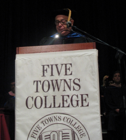 Melville Chamber of Commerce founder Mike DeLuise addresses the graduating class.