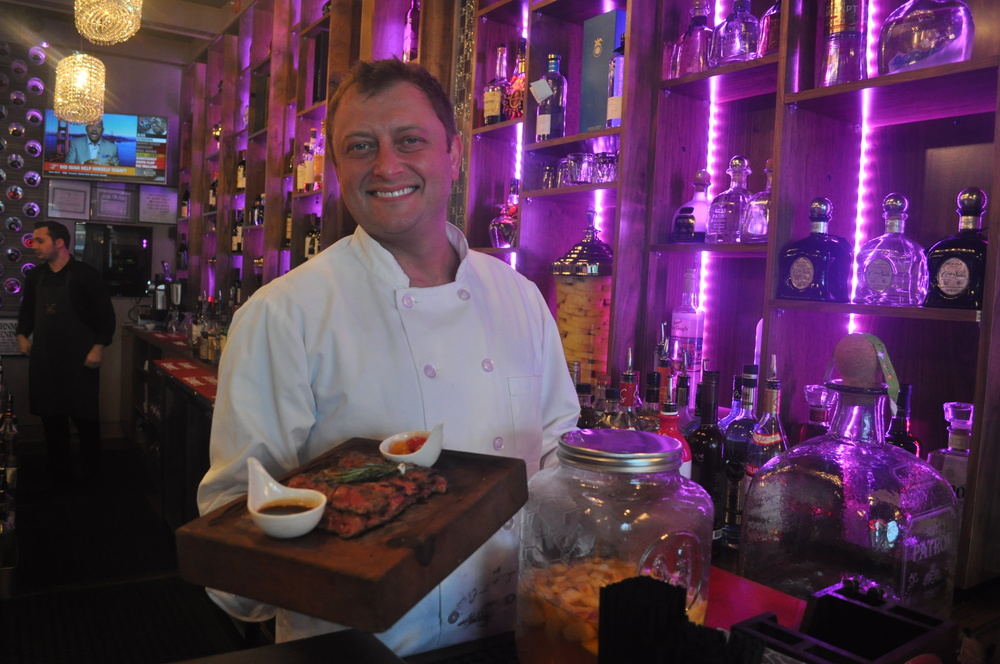 Imperial Meat Company executive chef Alexander Chernikov displays exquisite Wagyu skirt steak, a specialty of the Huntington village restaurant.